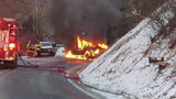 Slick road conditions to blame for a fiery two car crash.