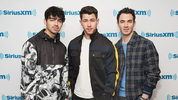 NEW YORK, NY - MARCH 01: (L-R) Joe Jonas, Nick Jonas and Kevin Jonas of The Jonas Brothers visit the SiriusXM studios on March 1, 2019 in New York City. (Photo by Cindy Ord/Getty Images for SiriusXM)