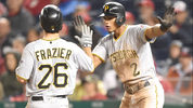 WASHINGTON, DC - APRIL 12: Adam Frazier #26 of the Pittsburgh Pirates and Erik Gonzalez #2 of the Pittsburgh Pirates celebrate scoring in the eight inning on Starling Marte #6 (not pictured) double. (Photo by Mitchell Layton/Getty Images)