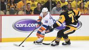 Anthony Beauvillier #18 of the New York Islanders skates with the puck against Jack Johnson #73 of the Pittsburgh Penguins during the first period in Game Four of the Eastern Conference First Round at PPG PAINTS Arena.