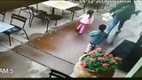 VIDEO: Car nearly hits family on restaurant patio