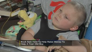 Family holds book sale to help buy wheelchair van for 4-year-old boy