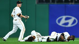 PITTSBURGH, PA - APRIL 19: Erik Gonzalez #2 and Starling Marte #6 of the Pittsburgh Pirates are injured after colliding during the eighth inning against the San Francisco Giants at PNC Park on April 19, 2019 (Photo by Joe Sargent/Getty Images)