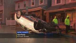 Man, granddaughter taken to hospital after car overturns in Garfield