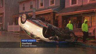 Man, granddaughter taken to hospital after car overturns in Garfield