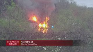 2 houses on fire, flames visible