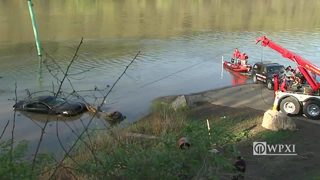 Crews pull car from Mon River 24 hours after it rolled in