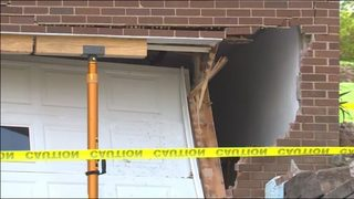 Driver taken to hospital after losing control, crashing into home
