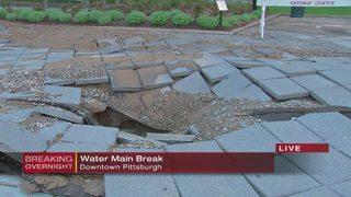 Water main break rips apart sidewalk, floods street in downtown Pittsburgh