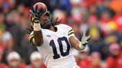 Devin Bush, a linebacker from Michigan, is seen her intercepting a pass. He was drafted #10 overall by the Pittsburgh Steelers in 2019.