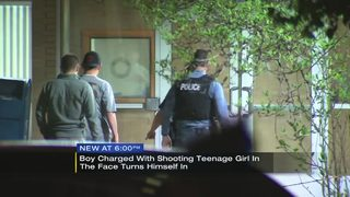 Boy charged with shooting teenage girl in face turns himself in