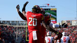 COLLEGE PARK, MD - NOVEMBER 17: Javon Leake #20 of the Maryland Terrapins celebrates with Derwin Gray #55 of the Maryland Terrapins after scoring a touchdown against the Ohio State Buckeyes during the first half. (Photo by Will Newton/Getty Images)