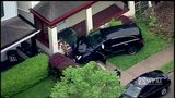 RAW VIDEO: SUV crashes into porch of Carrick home