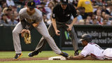 PHOENIX, ARIZONA - MAY 13: Jarrod Dyson #1 of the Arizona Diamondbacks safely steals third base against Kevin Newman #27 of the Pittsburgh Pirates. (Photo by Jennifer Stewart/Getty Images)