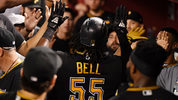 PHOENIX, ARIZONA - MAY 14: Josh Bell #55 of the Pittsburgh Pirates celebrates with teammates in the dugout after hitting a home run off of Zack Godley of the Arizona Diamondbacks in the eighth inning at Chase Field on May 14, 2019 in Phoenix, Arizona. It was Bell's second home run of the game. (Photo by Norm Hall/Getty Images)