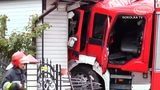 VIDEO: Fire truck crashes into car and house