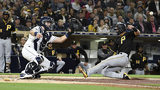 SAN DIEGO, CA - MAY 16: Kevin Newman #27 of the Pittsburgh Pirates scores ahead of the throw to Austin Hedges #18 of the San Diego Padres during the fifth inning of a baseball game at Petco Park May 16, 2019 in San Diego, California. (Photo by Denis Poroy/Getty Images)