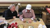Pete Rose signs autographs for fans in Pittsburgh while being interviewed by Channel 11's Alby Oxenreiter.