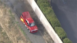 Truck bursts into flames during police chase
