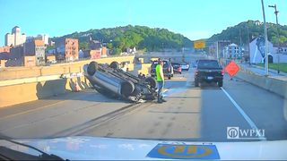 Car overturned on Veterans Bridge off ramp to 279 North