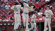 CINCINNATI, OH - MAY 29: Josh Bell #55 of the Pittsburgh Pirates celebrates with Starling Marte #6 after hitting a three-run home run in the seventh inning against the Cincinnati Reds at Great American Ball Park (Photo by Joe Robbins/Getty Images)