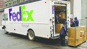 A FedEx Ground truck makes a stop at a business along Oliver Avenue. (Pittsburgh Business Times)
