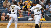 Starling Marte #6 celebrates with Jose Osuna #36 of the Pittsburgh Pirates after scoring during the second inning against the Atlanta Braves at PNC Park on June 4, 2019 in Pittsburgh, Pennsylvania. (Photo by Joe Sargent/Getty Images)