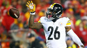 KANSAS CITY, MP - JANUARY 15: Running back Le'Veon Bell #26 of the Pittsburgh Steelers tosses the ball forward after gaining a first down against the Kansas City Chiefs. (Photo by Dilip Vishwanat/Getty Images)
