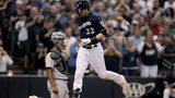 MILWAUKEE, WISCONSIN - JUNE 09: Christian Yelich #22 of the Milwaukee Brewers crosses home plate after hitting a home run in the sixth inning against the Pittsburgh Pirates at Miller Park on June 09, 2019 (Photo by Dylan Buell/Getty Images)