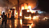 Flames engulf tractor-trailer, fuel pumps at turnpike service plaza