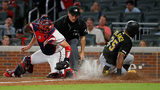 ATLANTA, GEORGIA - JUNE 12: Gregory Polanco #25 of the Pittsburgh Pirates scores past Tyler Flowers #25 of the Atlanta Braves on a sacrifice by Corey Dickerson #12 in the sixth inning at SunTrust Park on June 12, 2019 in Atlanta, Georgia. (Photo by Kevin C. Cox/Getty Images)