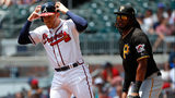Freddie Freeman #5 of the Atlanta Braves reacts towards the Pittsburgh Pirates bench after a failed attempt to pick him off at first base with Josh Bell #55 in the first inning at SunTrust Park on June 13, 2019. (Photo by Kevin C. Cox/Getty Images)