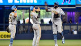 MIAMI, FL - JUNE 16: Gregory Polanco #25 of the Pittsburgh Pirates high fives Kevin Newman #27 after defeating the Miami Marlins at Marlins Park on June 16, 2019 in Miami, Florida. (Photo by Eric Espada/Getty Images)