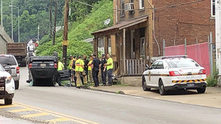 Driver runs after car hits porch, overturns