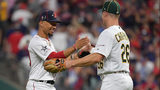 CLEVELAND, OHIO - JULY 09: Matt Chapman #26 of the Oakland Athletics and Mookie Betts #50 of the Boston Red Sox participate in the 2019 MLB All-Star Game at Progressive Field on July 09, 2019 in Cleveland, Ohio. (Photo by Jason Miller/Getty Images)
