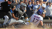 CHICAGO, ILLINOIS - JULY 12: Kris Bryant #17 of the Chicago Cubs scores the game-winning run in the 8th inning ahead of the tag by Jacob Stallings #58 of the Pittsburgh Pirates at Wrigley Field on July 12, 2019 (Photo by Jonathan Daniel/Getty Images)