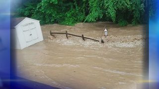 Neighbors blame nearby creek, township officials as flood cleanup continues