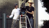 LOS ANGELES, CA - NOVEMBER 18: A director and camera technician set up a camera for the shooting of an auto insurance commercial on-location downtown on November 18, 2006 in Los Angeles, California.  (Photo by David McNew/Getty Images)