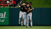 Corey Dickerson #12, Starling Marte #6 and Bryan Reynolds #10 of the Pittsburgh Pirates celebrate after beating the St. Louis Cardinals at Busch Stadium on July 16, 2019 in St Louis, Missouri. (Photo by Dilip Vishwanat/Getty Images)