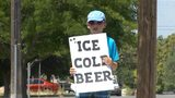 Kid sets up stand selling ICE COLD root BEER