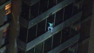 Man climbs down burning Philly high-rise