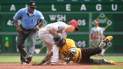 PITTSBURGH, PA: Starling Marte of the Pittsburgh Pirates is tagged out at second base by Scott Kingery of the Philadelphia Phillies in the sixth inning during the game at PNC Park. (Photo by Justin Berl/Getty Images)
