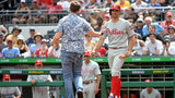 PITTSBURGH, PA: Brad Miller of the Philadelphia Phillies backs away from a fan who came onto the field in the sixth inning during the game against the Pittsburgh Pirates at PNC Park in Pittsburgh, Pennsylvania. (Photo by Justin Berl/Getty Images)