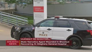 Officer wounded in shopping center shootout is expected to recover, police say