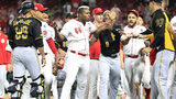 Yasiel Puig #66 of the Cincinnati Reds is restrained during a bench clearing altercation in the 9th inning of the game against the Pittsburgh Pirates at Great American Ball Park on July 30, 2019 in Cincinnati, Ohio. (Photo by Andy Lyons/Getty Images)