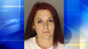 Cunningham is charged after police found drugs and guns inside the Duquesne home where she lives.
