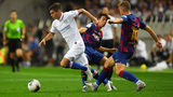 JAPAN: Christian Pulisic of Chelsea runs past Oriol Busquets and Riqui Puig of Barcelona during the preseason friendly match between Barcelona and Chelsea on July 23, 2019 in Saitama Japan. (Photo by Atsushi Tomura/Getty Images).