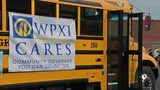 Help 11 Cares Pack the Bus