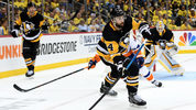 Erik Gudbranson #44 of the Pittsburgh Penguins moves the puck up ice against the New York Islanders during the third period in Game Three of the Eastern Conference First Round during the 2019 NHL Stanley Cup. (Photo by Justin Berl/Getty Images)