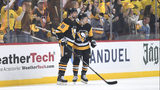Jake Guentzel #59 of the Pittsburgh Penguins celebrates with Brian Dumoulin #8 after scoring a goal during the first period in Game Four of the Eastern Conference First Round against the New York Islanders. (Photo by Justin Berl/Getty Images)
